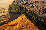 Namibia;  Namib Desert, Kuiseb River, aerial view, Namib-Naukluft National Park; the Kuiseb River prevents the sand dunes from moving further south