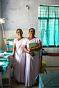 57 year old Usha Srivastava  and her colleague Usha Devi (right) pose for a photo at the delivery room of the Public Health Centre in Adapur village of Raxaul district of Bihar.