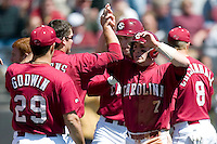 South Carolina catcher Trent Cline (7) high fives teammates after scoring in the 6th inning versus LSU at Sarge Frye Stadium in Columbia, SC, Thursday, March 18, 2007.