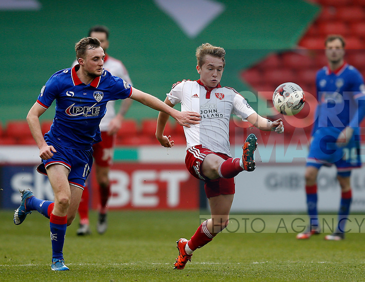 Carl Winchester of Oldham Athletic tussles with Louis Reed of Sheffield Utd during the Sky Bet League One match at The Bramall Lane Stadium.  Photo credit should read: Simon Bellis/Sportimage
