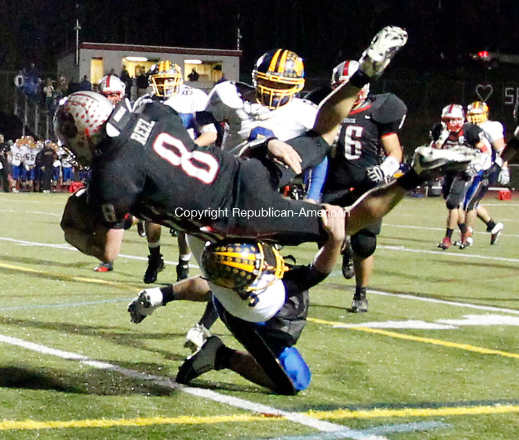 Southbury, CT- 05, November 2010-110510CM04  Pomperaug's James Reel (#8) get's flipped over Brookfield's Nick Paez Friday night in Southbury. Christopher Massa Republican-American