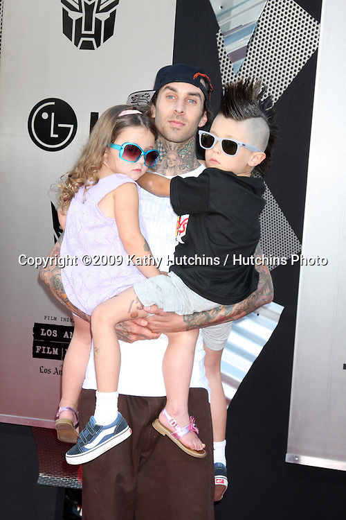 """Travis Barker & kids arriving at the """"Transformers: Revenge of the Fallen"""" Premiere at the Mann's Village Theater in Westwood, CA  on June 22, 2009.  .©2009 Kathy Hutchins / Hutchins Photo"""