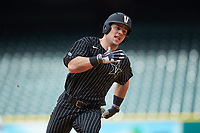 Walker Grisanti (17) of the Vanderbilt Commodores hustles towards third base against the Sam Houston State Bearkats in game one of the 2018 Shriners Hospitals for Children College Classic at Minute Maid Park on March 2, 2018 in Houston, Texas. The Bearkats walked-off the Commodores 7-6 in 10 innings.   (Brian Westerholt/Four Seam Images)