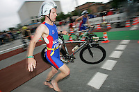 02 SEP 2007 - HAMBURG, GER - Patrick Hazard (GBR) races into transition after the bike leg - World Age Group Triathlon Championships. (PHOTO (C) NIGEL FARROW)