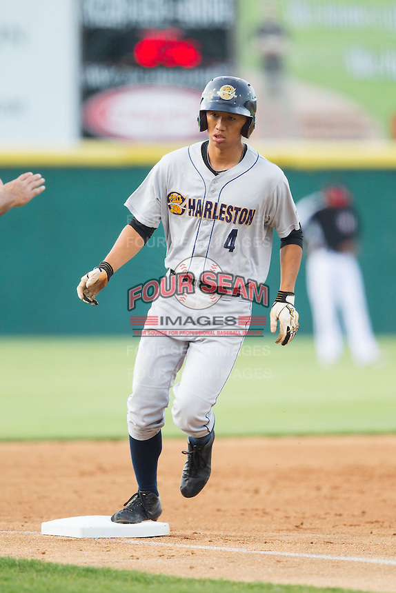 Gosuke Katoh (4) of the Charleston RiverDogs rounds third base after hitting a solo home run against the Hickory Crawdads at L.P. Frans Stadium on June 2, 2014 in Hickory, North Carolina.  The Crawdads defeated the RiverDogs 9-6.  (Brian Westerholt/Four Seam Images)