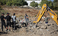 Pictured: A digger assists forensics officers with the preliminary search at the new site in Kos, Greece. Friday 07 October 2016<br /> Re: Police teams led by South Yorkshire Police, searching for missing toddler Ben Needham on the Greek island of Kos have moved to a new area in the field they are searching.<br /> Ben, from Sheffield, was 21 months old when he disappeared on 24 July 1991 during a family holiday.<br /> Digging has begun at a new site after a fresh line of inquiry suggested he could have been crushed by a digger.