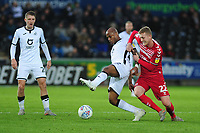Andre Ayew of Swansea City vies for possession with George Saville of Middlesbrough during the Sky Bet Championship match between Swansea City and Middlesbrough at the Liberty Stadium in Swansea, Wales, UK. Saturday 14 December 2019