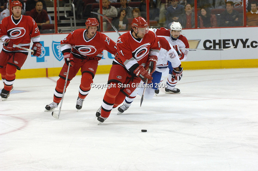 Carolina Hurricanes Justin Williams brings the puck up ice against the Montreal Canadiens during an NHL hockey game Thursday, Nov. 2, 2006 in Raleigh, NC. He is followed by teammates Eric Staal and Mike Commodore.<br />