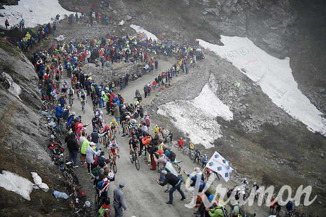 the grupetto up the dirt roads of the Colle delle Finestre (2178m)<br /> <br /> Giro d'Italia 2015<br /> stage 20: Saint Vincent - Sestriere (199km)