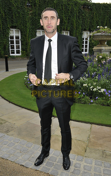 LONDON, ENGLAND - AUGUST 28: Martin Keown attends the Mo Farah Foundation &quot;A Night Of Champions&quot; Dinner, The Hurlingham Club, Ranelagh Gardens, on Thursday August 28, 2014 in London, England, UK. <br /> CAP/CAN<br /> &copy;Can Nguyen/Capital Pictures