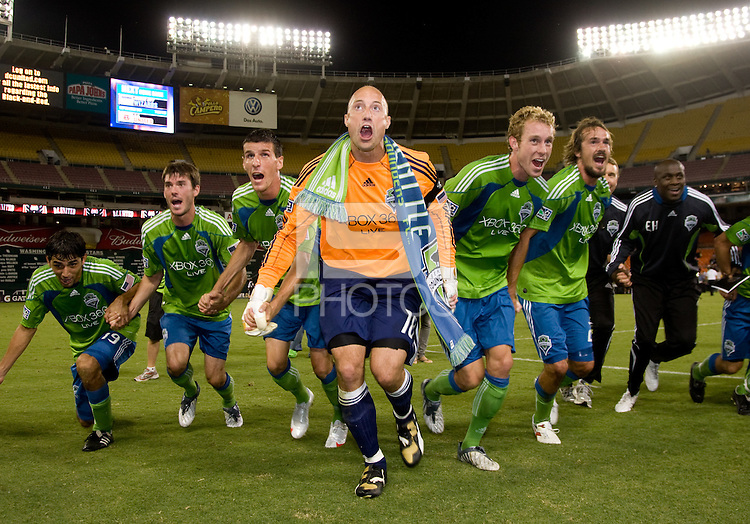 Seattle Sounders captain Kasey Keller saluates the crowd with his teammates after the Lamar Hunt U.S. Open Cup at RFK Stadium in Washington, DC.  The Seattle Sounders defeated DC United, 2-1.