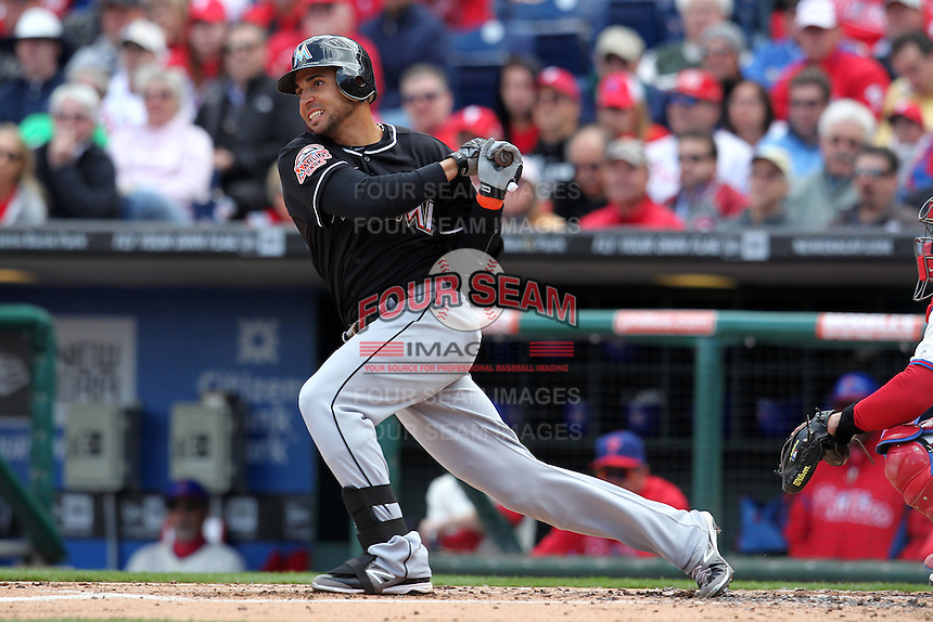 Miami Marlins second baseman Omar Infante #12 during a game against the Philadelphia Phillies at Citizens Bank Park on April 9, 2012 in Philadelphia, Pennsylvania.  Miami defeated Philadelphia 6-2.  (Mike Janes/Four Seam Images)
