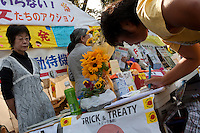 Women sign in as they attend an Anti nuclear protest by women outside the Ministry of Economy, Trade and Industry (METI) in Tokyo Japan. Friday November 4th 2011. The protest ran from October 27th to Noverber 5th. Originally started my mothers from Fukushima protesting about nuclear contamination from October 30th to November 5th the protest welcomed women and people from all over Japan.