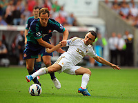 Saturday, 01 September 2012<br /> Pictured: Leon Britton of Swansea (R) tackling David Meyler of Sunderland (L)<br /> Re: Barclays Premier League, Swansea City FC v Sunderland at the Liberty Stadium, south Wales.