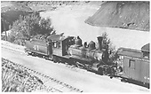 RGS 2-8-0 #41 on rear helper duty, pushing on caboose #0403 in the south Durango yards.<br /> RGS  Durango, CO  Taken by Kindig, Richard H. - 7/1/1938