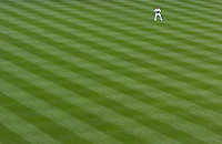 A lone fielder patrols a spacious outfield in Yankee Stadium..
