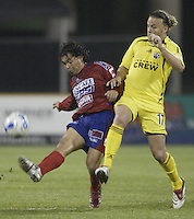 08 November 2006: CSD Municipal's Sergio Guevara, left, kicks the ball past Columbus Crew's Danny Szetela during the second half in Columbus, Ohio.<br />
