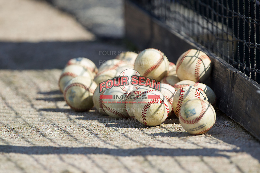 A pile of baseballs sit outside the home dugout prior to the South Atlantic League game between the Hagerstown Suns and the Kannapolis Intimidators at CMC-Northeast Stadium on May 31, 2014 in Kannapolis, North Carolina.  The Intimidators defeated the Suns 3-2 in game one of a double-header.  (Brian Westerholt/Four Seam Images)