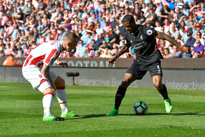 Liverpool's Georginio Wijnaldum under pressure from Stoke City's Glenn Whelan<br /> <br /> Photographer Terry Donnelly/CameraSport<br /> <br /> The Premier League - Stoke City v Liverpool - Saturday 8th April 2017 - bet365 Stadium - Stoke-on-Trent<br /> <br /> World Copyright &copy; 2017 CameraSport. All rights reserved. 43 Linden Ave. Countesthorpe. Leicester. England. LE8 5PG - Tel: +44 (0) 116 277 4147 - admin@camerasport.com - www.camerasport.com