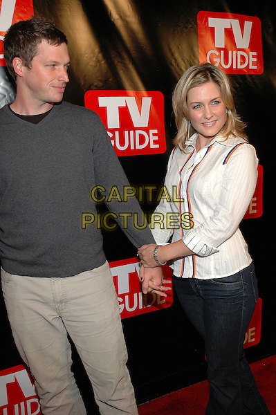 SYD BUTLER & AMY CARLSON.The New Big TV Guide launch party at the Home and Guest House Club in Chelsea, New York, New York..October 11th, 2005.Photo Credit: Patti Ouderkirk/AdMedia.Ref: PO/ADM/CAP.half length white blouse jeans denim holding hands grey gray sweater.www.capitalpictures.com.sales@capitalpictures.com.© Capital Pictures.