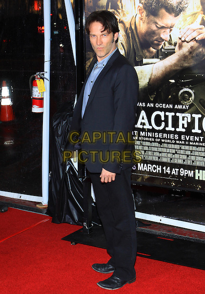"STEPHEN MOYER .Attending the Los Angeles Premiere of HBO's ""The Pacific"" held at Grauman's Chinese Theater, Hollywood, California, USA, 24th February 2010 .full length blue shirt suit black jacket navy side .CAP/ADM/TC.©T. Conrad/AdMedia/Capital Pictures."
