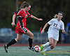 Island Trees No. 17 Megan Fischer, left, moves the ball across midfield during a Nassau County varsity girls' soccer Class A semifinal against Garden City at Cold Spring Harbor High School on Friday, October 30, 2015. Garden City won by a score of 2-0.<br /> <br /> James Escher