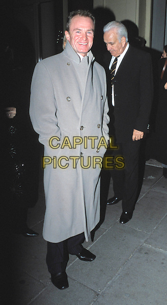 BOBBY DAVRO.Thoroughly Modern Millie London premiere & press night & afterparty at the Waldorf Hotel.full length, full-length, long grey coat.www.capitalpictures.com.sales@capitalpictures.com.© Capital Pictures.