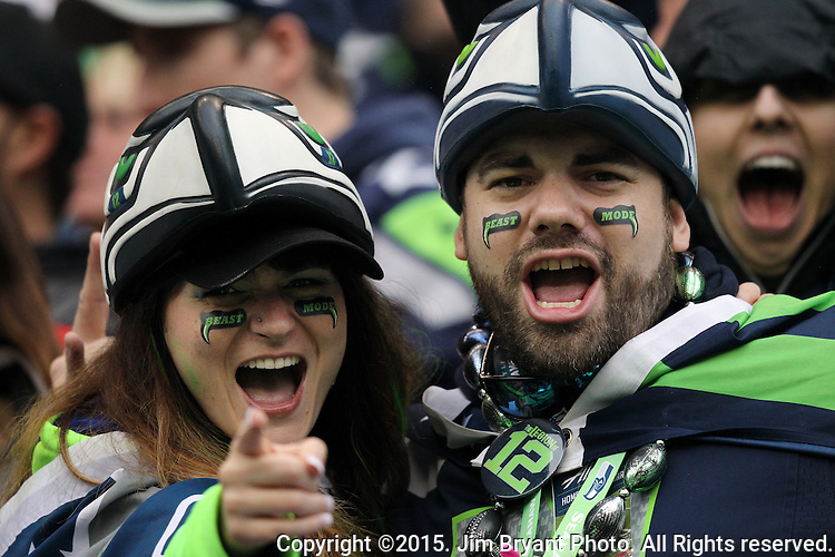 Seattle Seahawks fans cheer against the Carolina Panthers  at CenturyLink Field in Seattle on October 18, 2015. The Panthers came from behind with 32 seconds remaining in the 4th Quarter to beat the Seahawks 27-23.  ©2015 Jim Bryant Photography. All Rights Reserved.