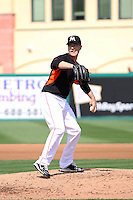 Chris Narveson (45) throws a pitch for the Miami Marlins during a spring training game against the University of Miami Hurricanes at the Roger Dean Complex in Jupiter, Florida on March 3, 2015. Miami defeated UM 7-1. (Stacy Jo Grant/Four Seam Images)
