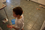 When I had to take a business call in my office, my younger son, then three, emptied a package of noodles on the kitchen floor. Here his older brother, age six, surveys the damage with righteous incredulity.