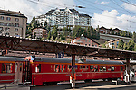 Swiss red Bernina Express trains stop at  St. Moritz, Switzerland