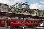 Swiss red Bernina Express trains stop at  St. Moritz, Switzerland