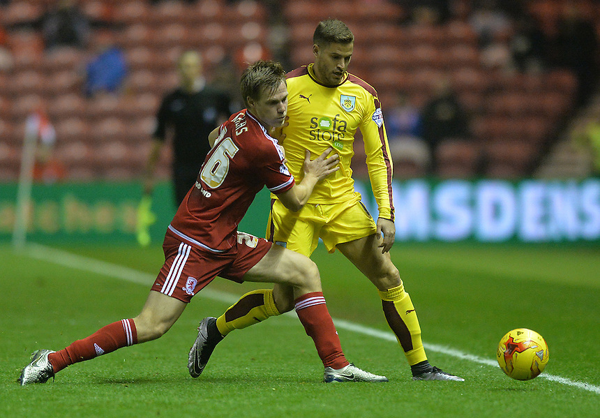 Middlesbrough's Tomas Kalas and Burnley's Michael Kightly battle for the ball<br /> <br /> Photographer Dave Howarth/CameraSport<br /> <br /> Football - The Football League Sky Bet Championship - Middlesbrough v Burnley - Tuesday 15th December 2015 - Riverside Stadium - Middlesbrough<br /> <br /> &copy; CameraSport - 43 Linden Ave. Countesthorpe. Leicester. England. LE8 5PG - Tel: +44 (0) 116 277 4147 - admin@camerasport.com - www.camerasport.com