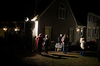 Camera crews work outside a house party where former Utah governor Jon Huntsman is speaking in Bedford, New Hampshire, on Jan. 8, 2012. Huntsman is seeking the 2012 Republican presidential nomination.