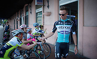 Iljo Keisse (BEL/Etixx-QuickStep) entertaining some kids waiting for riders returning from the Giro 2015 Official Team Presentation (in San Remo)