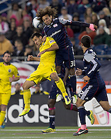 Columbus Crew midfielder Dilly Duka (11) and New England Revolution defender Kevin Alston (30) battle for head ball.  In a Major League Soccer (MLS) match, the Columbus Crew defeated the New England Revolution, 3-0, at Gillette Stadium on October 15, 2011.