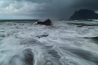 Waves flow over Uttakleiv beach in autumn storm, Vestvågøy, Lofoten Islands, Norway