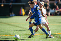 Seattle, WA - Sunday, May 1, 2016: Seattle Reign FC midfielder Keelin Winters (11) drives past FC Kansas City midfielder Jen Buczkowski (6) during a National Women's Soccer League (NWSL) match at Memorial Stadium. Seattle won 1-0.