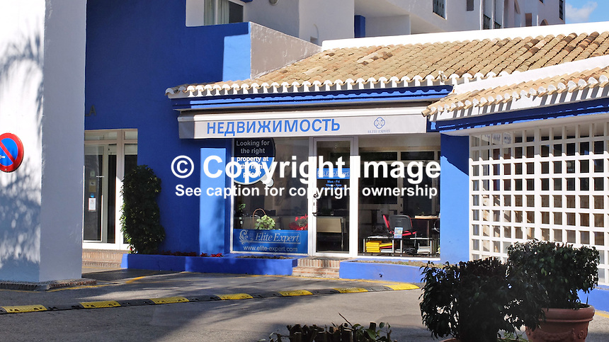 Signage in Russian on the Costa del Sol, Spain, shows its popularity with Russian ex-pats &amp; tourists. Estate agency, Puerto Banus, February, 2015, 201502060386<br />