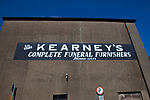 Kearney's undertaker - end of building painting in Selskar, in Wexford, Ireland