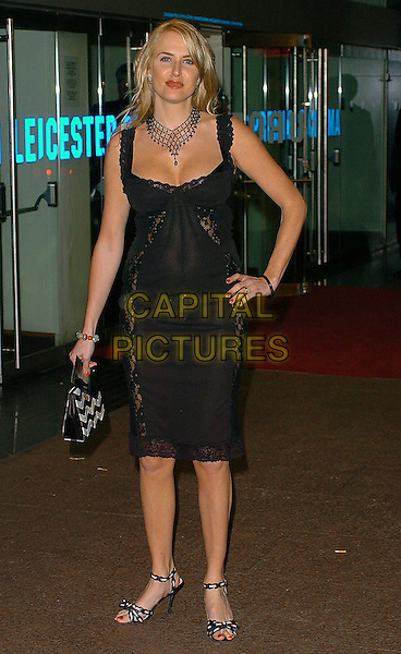 """NANCY SORRELL.""""King Kong"""" UK film premiere at Leicester Square, London, UK..December 8th, 2005.Ref: CAN.full length black dress lace hand on hip.www.capitalpictures.com.sales@capitalpictures.com.©Capital Pictures"""