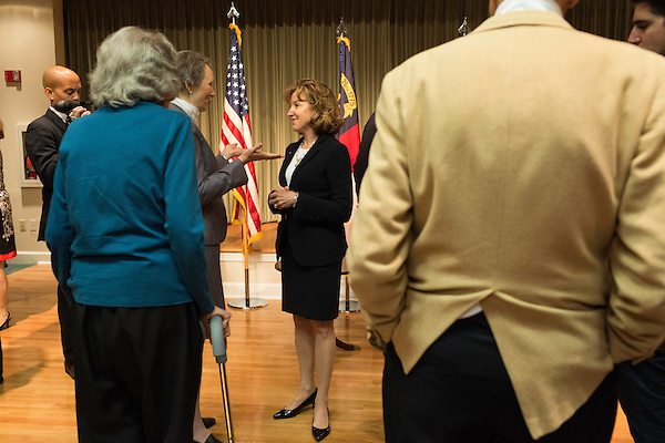 """April 16, 2014. Durham, North Carolina.<br />  Senator Kay Hagan, center, spoke with the audience after an event to award a posthumous Bronze Star. Hagan has been largely absent from the campaign trail even as several Republican challengers have mounted campaigns to defeat her in this year's election.<br />  Kay Hagan (D),  US Senator from North Carolina, attended an event to honor the military service of Donald """"Buddy"""" Moore, Hagan awarded Moore's widow Wanda a posthumous Bronze Star, as well as several other medals, for his service in World War II."""