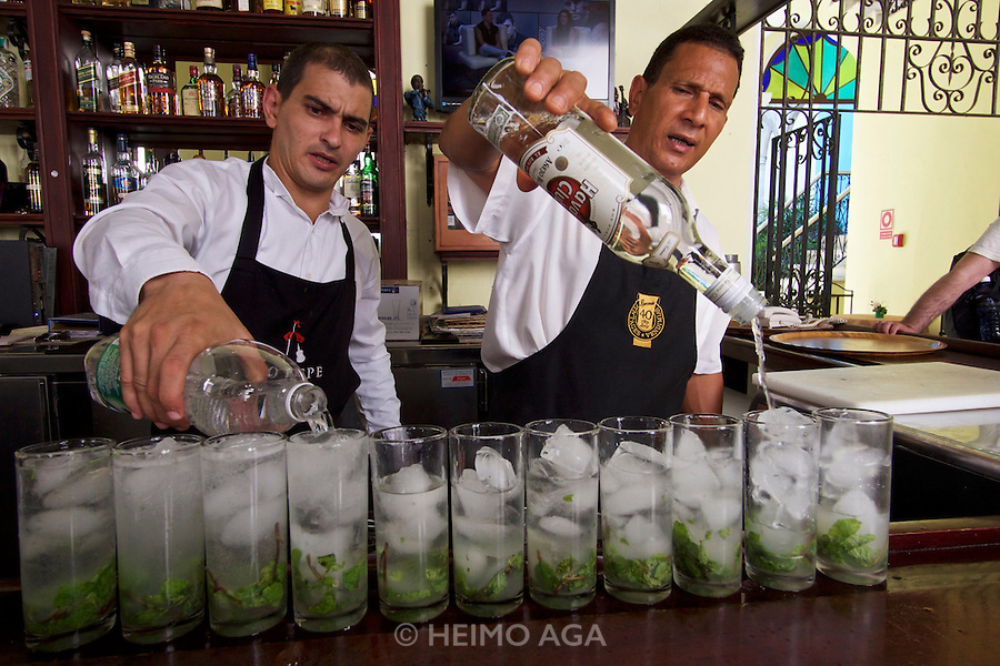 Havana, Cuba. La Habana Vieja (Old Habana). Mass production of Mojitos at Hotel Tejadillo.
