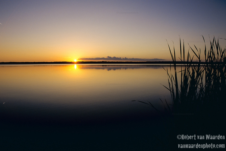 Sunset on Lake Audy with reeds in the province of Manitoba in Canada.