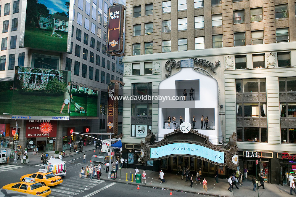 19 July 2005 - New York, USA - Models dance and play around in a Clavin Klein bottle shaped billboard overlooking Times Square in New York City, NY, United States, July 19, 2005. The 2-day 'live' advertising stunt was unveiled July 19th to announce the launch of a new campaign for the fragrance. According to a Calvin Klein spokesperson, the models spend 3 hours at a time in the billboard. Photo Credit: David Brabyn.