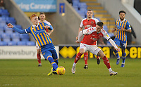 Shrewsbury Town's Ryan Haynes under pressure from Fleetwood Town's Wes Burns<br /> <br /> Photographer Kevin Barnes/CameraSport<br /> <br /> The EFL Sky Bet League One - Shrewsbury Town v Fleetwood Town - Tuesday 1st January 2019 - New Meadow - Shrewsbury<br /> <br /> World Copyright © 2019 CameraSport. All rights reserved. 43 Linden Ave. Countesthorpe. Leicester. England. LE8 5PG - Tel: +44 (0) 116 277 4147 - admin@camerasport.com - www.camerasport.com