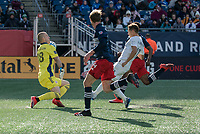 FOXBOROUGH, MA - MARCH 7: Brad Knighton #18 of New England Revolution blocks a shot on goal by Przemyslaw Frankowski #11 of Chicago Fire during a game between Chicago Fire and New England Revolution at Gillette Stadium on March 7, 2020 in Foxborough, Massachusetts.