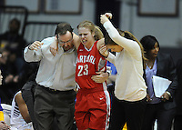 Sophomore Morgan Lumb is helped of the of the court after aggravating an earlier injury.  Albany claimed the America East Championship for the forth year in a row with a 84-75 win over the Hawks.  Steve McLaughlin / Special to The Courant