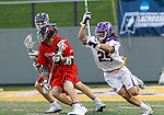 Stone Sims (#25) defends Richmond attack Teddy Hatfield (#14) as UAlbany Men's Lacrosse defeats Richmond 18-9 on May 12 at Casey Stadium in the NCAA tournament first round.