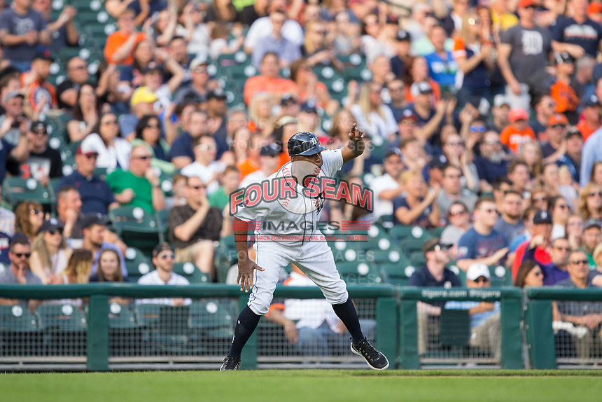 Detroit Tigers third base coach Dave Clark (25) signals to a runner during the game against the Chicago White Sox at Comerica Park on June 2, 2017 in Detroit, Michigan.  The Tigers defeated the White Sox 15-5.  (Brian Westerholt/Four Seam Images)